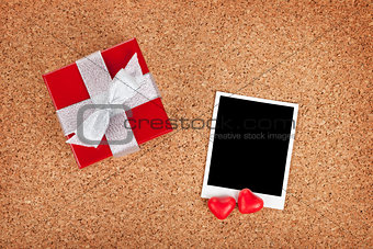 Blank valentines photo frame and small red gift box