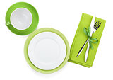 Empty green plates, coffee cup and silverware