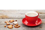 Coffee cup and gingerbread cookies