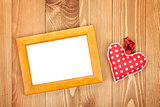 Blank photo frame and red Valentine's day heart toy