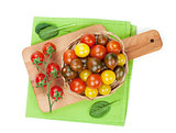 Colorful cherry tomatoes on cutting board
