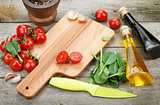 Fresh ingredients for cooking: pasta, tomato, salad and spices