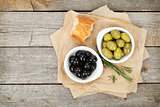 Italian food appetizer of olives, bread and herbs
