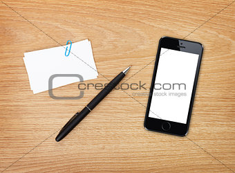 Business cards, pen and mobile phone