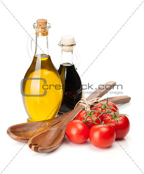 Tomatoes with spices and kitchen utensils
