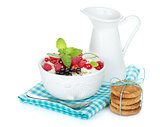 Fresh corn flakes with berries and milk jug