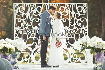 Groom and bride on wedding day.
