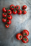 fresh red delicious tomatoes  on an  old wooden tabletop backgro