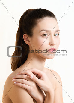 Beautiful young adult woman with clean fresh skin. Wellness