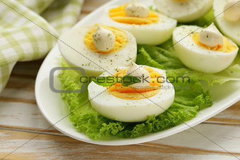 appetizer of boiled eggs with mayonnaise and spices
