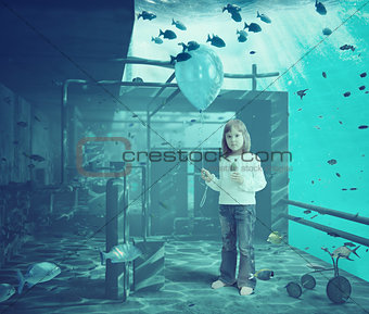 litle girl with ball underwater