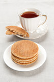 tea in a cup with biscuits