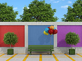 Street with bench and colorful balloons