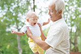 Asian grandfather playing with grandson