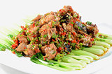 Chinese Food: Fried fish head pieces with green vegetables