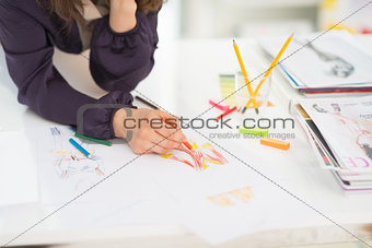 Closeup on fashion designer making sketches