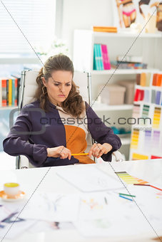 Concerned fashion designer in office