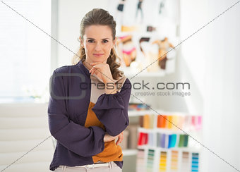 Portrait of fashion designer in office
