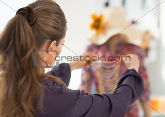 Closeup on fashion designer choosing accessories