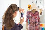Fashion designer taking photo of mannequin