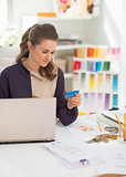 Happy fashion designer making online shopping