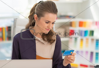 Portrait of happy fashion designer making online shopping