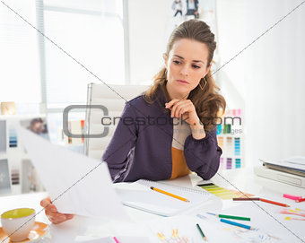 Portrait of fashion designer at work