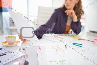 Closeup on fashion designer at work