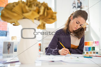 Fashion designer working in office