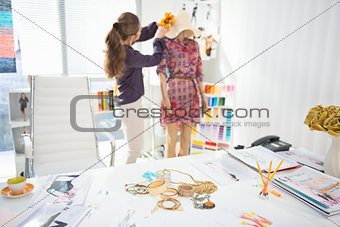 Closeup on accessories on table and fashion designer decorating