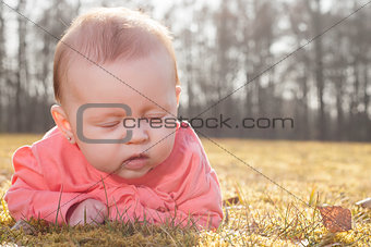 slleeping baby on the grass