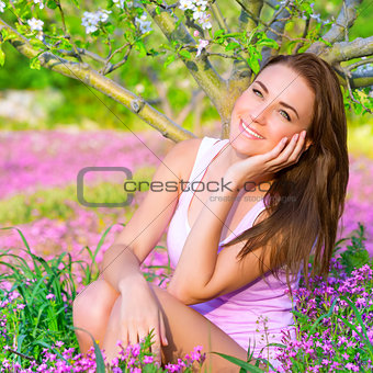 Dreamy girl in spring garden