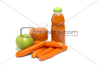 Apples, carrot and juice in glass
