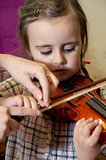 preschool child learning violin playing