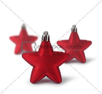 Three red Christmas decoration stars