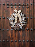 Christmas wreath on wooden door