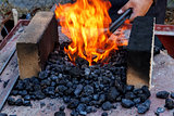 blacksmith furnace with burning coals