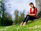 Woman reading outside in spring