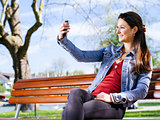 Smiling woman taking a selfie