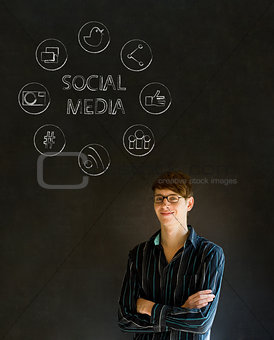 Business man or teacher with social media icons chalk blackboard background