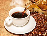 hot coffee from arabic copper turks and  scattered coffee grains