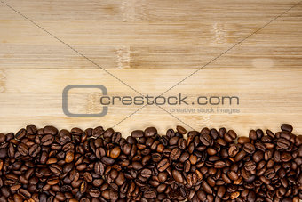 A pile of coffee beans forming a simple stripe frame