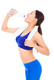 after exercising , pretty woman drinking water