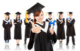 pretty graduation student thumb up with classmates