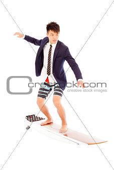 businessman practice surfing pose