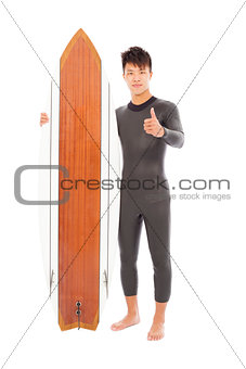 surfer man holding a surfboard and thumb up