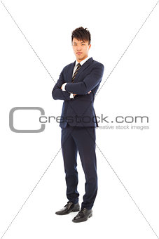 Confident businessman standing and  crossed arms