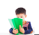 Asian kid reading a book