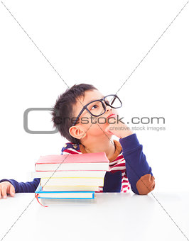 little boy thinking or dreaming during preparing homework