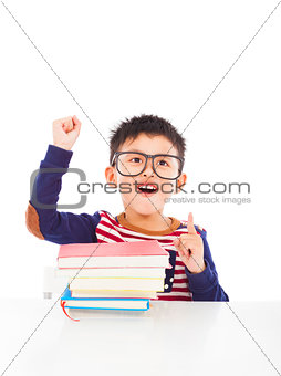 little boy think out a good ideas and raise hand